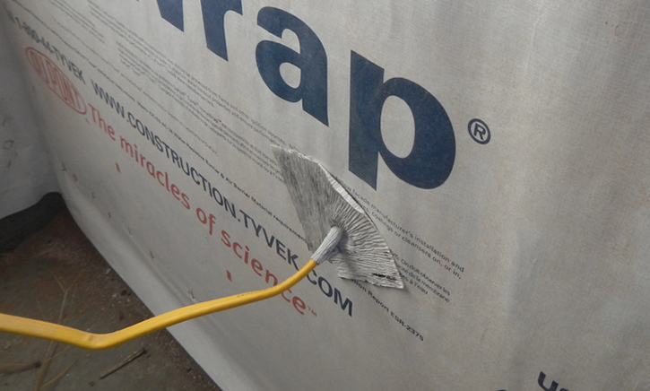 Flashing Panel with Housewrap Tape Above Conduit/Pipe Overlapping Housewrap with Flex Tape Around the Top