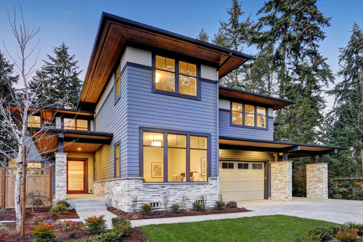 Beautiful new house with blue exterior paint and stone work